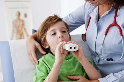 Child with asthma taking breathing spirometry test in New Orleans, LA