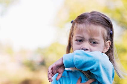 Little girl coughing from asthma in New Orleans, LA