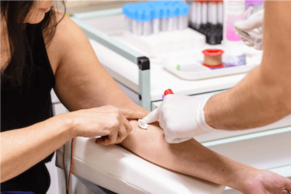Allergist performs blood test to diagnose food allergies