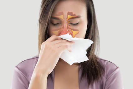 Woman with sinusitis pain and pressure in her sinuses